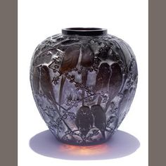 Bonham's - René Lalique -   'Perruches' a Vase, design 1919 deep amber glass, heightened with staining 25.1cm high, etched 'R. Lalique France'      Estimate: USD 29,000 - 35,000