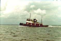 The tug Janet running free in Pensacola Bay