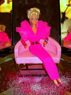 https://flic.kr/p/82F4Vy   Pink Jubilee Barbie   This photo was taken especially for (Boxer77) The fashion is from 1982, its an evening fashion- no name specific- She is always wearing the pink sleeves from (Jewel Secrets Whitney) Dangle earings from (Rockers Barbie) and a braclet from the (Perfume Pretty Barbie) collection, and Pink Mules