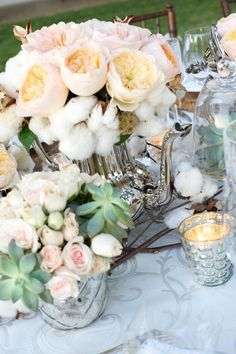 We are loving the vintage teapots with flowers and succulents for the rustic looking centerpieces!