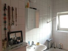 Bathroom light. Window in shower/bathtub. Necklace holders.