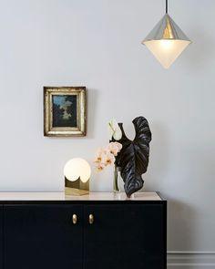 #Half&Half pendant, #Atlas table lamp, and @jasonmillerstudio credenza at our 3 Mercer St. showroom⠀
