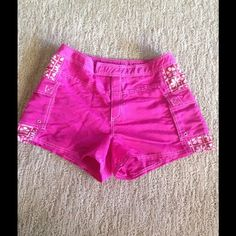 Spring break is just around the corner These bright pink board shorts are perfect to wear alone or over your bikini! Velcro closure and has two pockets. Swim