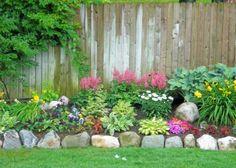 Back yard flower bed Flower Bed Plants, Rock Flower Beds, Planting Flowers, Landscaping With Rocks, Outdoor Landscaping, Front Yard Landscaping, Landscaping Ideas, Paradise Garden, Dream Garden