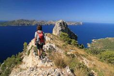 Gazing out from Mallorca's distinctive limestone peaks. Image by Andy Christiani / Lonely Planet. Recommended hiking trails near Soller.
