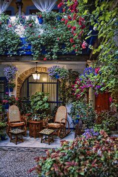 Patios at Cordoba, Andalucia, Spain. Looks like a Thomas Kincaide painting! :)