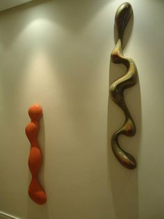 wall sculpture, wooden sculpture, fiber glass sculpture.