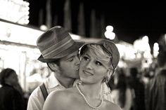 1950s retro vintage styled engagement session, 1950s retro vintage couple at the North Carolina State Fair  #kiss #kisses #kissing #couple #love #passion #romance #fair