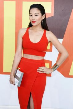 "Actress Arden Cho from ""Teen Wolf"" matched her electric red lips to her ensemble, while her kohl-lined eyes and slicked back half-do kept all the attention on her dewy skin."