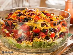 The ranch-flavored tortilla chips and sweet-and-spicy French dressing really add a whole other layer of flavor to this impressive Taco Salad. Set this beautiful salad out in a clear bowl, and watch...
