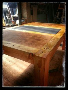 Large coffee table from 90 year old reclaimed joists, end grain Douglas Fir and slate inlay by jdwoodwork.co.uk