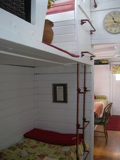 The beds inside an adorable caboose house.