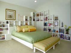 Stylish and Unique Headboard Ideas: A wall of shelving not only acts as a sleek headboard, but it also maximizes the storage in this bedroom. Design by Elizabeth Brownrigg. From DIYnetwork.com