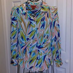 Missoni for Target blouse, Size Medium Remember when Missoni did a collection for Target and everybody lost their damn fool minds? This is a shirt from that collection. It a beautiful button-down, long-sleeved blouse in gorgeous colors.100% polyester. A great shirt. Missoni  Tops Blouses