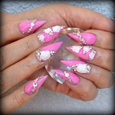 pink stiletto nail claws with tones of crystals and 3D roses