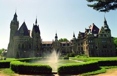 Moszna Castle, Poland | One of Poland's most beautiful castles. Built in 17th century, it has exactly 99 turrets, 365 rooms (with a total floorage of 7,000 m2) and a cubic capacity of about 65,000 m3.