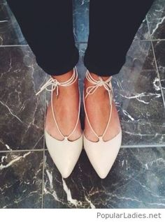 Nude lace up flats with black pants