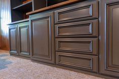 Blue Gray Painted Cabinetry with Glaze accenting Applied Molding Doors Full Overlay Cabinetry