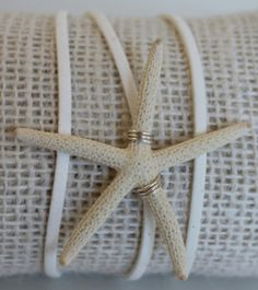item #B108 Tidepool reflects the beautiful sea treasures that hide beneath the cool damp rocks in their own rocky pools near the ocean- made with hand and selected white starfish are wrapped on a faux suede cord.