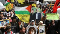 Palestinian families whose relatives are being held in Israeli jails protest in the West Bank city of Hebron, on April 15, 2015
