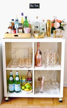 Bar Cart Essentials { wineglasswriter.com }  http://www.saradujour.me/2015/12/bar-cart-essentials-home-bar-haul/
