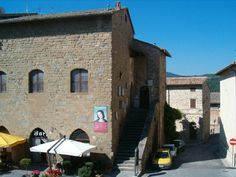 Bettona, Umbria. I want to be sitting under one of those umbrellas, sipping an espresso