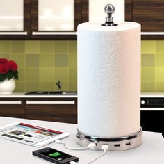 TowlHub with 4 USB Ports - SkyMall Power up all of your devices with this one-of-a-kind paper towel holder that also sports four USB ports.  No more fighting over outlets to charge your devices!