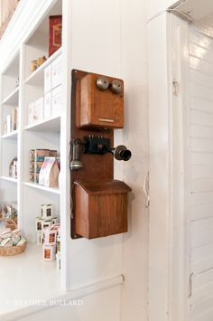 I love this old telephone for my kitchen! This site has other great pictures of decorating ideas too.