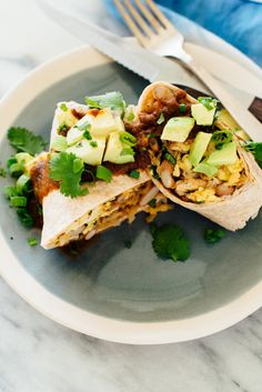 These breakfast burritos are amazing! They\'re stuffed with scrambled eggs and beans, easy homemade hash browns and fresh herbs. Enjoy them now and freeze the extra burritos for quick meals later. #breakfastburritos #freezerburritos #makeahead #vegetarianrecipe #breakfastrecipe