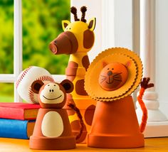Adorable! Head out on safari with these animals made out of clay pots :) #decor #creativitymadesimple