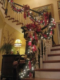 Decorated Christmas Staircase...there are many other fantastic decorating ideas on this blog.  (I don't have a staircase, put could use it on the mantel)