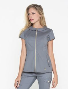 The Peter Pan Top in Graphite is a contemporary addition to women& medical scrub outfits. Shop Jaanuu for scrubs, lab coats and other medical apparel. Spa Uniform, Scrubs Uniform, Nursing Wear, Nursing Clothes, Lab Coats For Men, Stylish Scrubs, Scrubs Outfit, Medical Scrubs, Nursing Scrubs