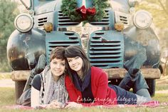 sisters pose in front of vintage truck for Christmas card photo