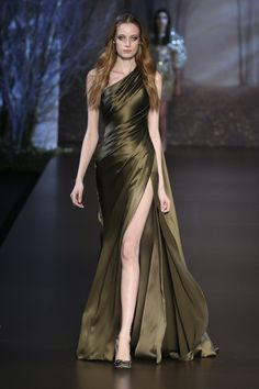 Ralph & Russo F/W 15/16: I love this draped satin one shoulder gown with thigh high slit. The color is a bit iffy to me but the fabric makes the color look exquisite and pleasant! The model has a mix of fierce and ethereal beauty