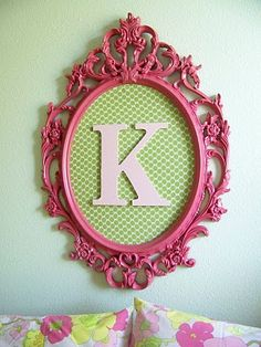 """Initial Art--paint a frame so it gives a pop of color, thrift stores are a great source for inexpensive ones. Use Lilly Pulitzer wallpaper as the backdrop and pop in a painted wood or paper mache letter. Voila! IKEA has a great mirror just like this that could be easily painted!  I can put one initial in each of two and the girls can have their """"own"""" dedicated dress up spaces :D"""