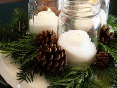 Mason Jars with salt and candles. A nice snowy looking contrast to fresh evergreens and pine cones.