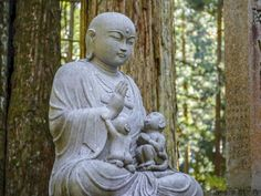 Jizo Bodhisattva, one of the most beloved Japanese divinities. Picture: iStock A walk through the Buddhist graveyard with a monk is like a tour of the Vatican with the Pope. Sit among pilgrims at Kobo Daishi's mausoleum and breathe in the atmosphere. Small bursts of silence between chanting offer a glimpse of the enduring stillness they seek.