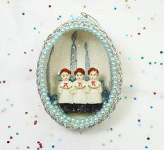 Vintage Beaded Christmas Ornament Egg Shell Choir Blue Glitter Holiday Decoration Black Friday Etsy PeachyChicBoutique. $8.95, via Etsy.