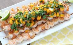 Easy, healthy and delicious grilled shrimp skewers served with fresh mango salsa! Perfect spring and summer barbecue dish! Slow Carb Recipes, Pork Rib Recipes, Grilling Recipes, Fish Recipes, Seafood Recipes, Whole Food Recipes, Cooking Recipes, Healthy Recipes, Seafood Dishes