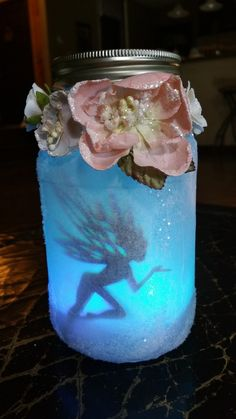 This Fairy Jar was created using color changing LEDs & Laser Cut fairy silhouettes.