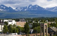 Cityscape of anchorage and the beautiful Chugach  mountains tower over the city