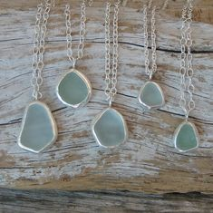 Pebble and sea glass art by Maine artist M.Pebble and sea glass art by Maine artist M. Sea Glass Necklace, Sea Glass Jewelry, Silver Jewelry, Gold Jewellery, Silver Ring, Pendant Necklace, Sea Glass Crafts, Sea Glass Art, Stained Glass