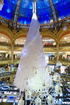 Arctic Christmas tree at Galeries Lafayette Haussmann, in Paris, France. The Christmas tree at Galeries Lafayette Haussmann is the work of artist Lorenzo Papace, in collaboration with paper manufacturer Arjowiggins. Christmas In Paris, French Christmas, Christmas Love, All Things Christmas, Christmas Lights, Christmas Displays, Beautiful Paris, I Love Paris, Paris Paris
