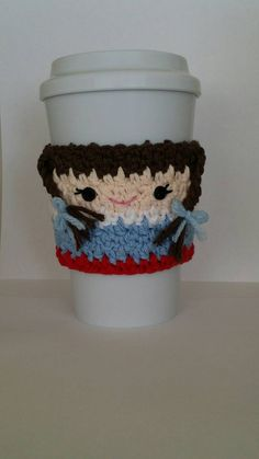 This cute little cozy was inspired by Dorothy from the Wizard of Oz. She will help keep your hands protected from hot coffee cups.    She