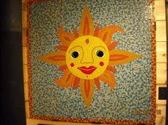 Mister Sun - Glass tiles and fused glass on cement board.