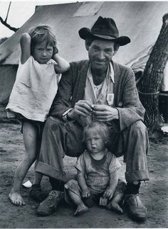 Traces of Texas ~ A migrant worker and his children camped by the side of the road near Raymondville, Texas.  This photo was taken in 1937 by Carl Mydans.