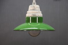 USA, 1940s, Vintage Silk Factory Drop Pendant Lights. Cast Iron, Porcelain, and Glass Construction. Classic Factory Lighting With Brilliant Kelly Green Porcelain Shades and Clear Glass Globes. Works Well as Counter Lighting. Custom Length Down-rods can be Provided to Spec. 3 Available.  factory20.com