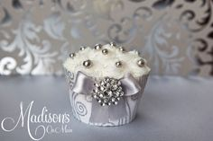 Another bling cupcake... - This is another version of the bling cupcake.  Only on this one I used an actual real rhinestone button.  Edible glitter on top with silver dragees.
