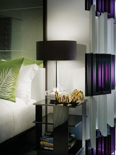 W South Beach, miami (yabu pushelberg). ilike the purple acrylic and the crackle- mirrored head board