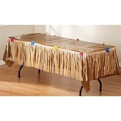 Grass table skirt.  Maybe you could DIY with brown paper bags?